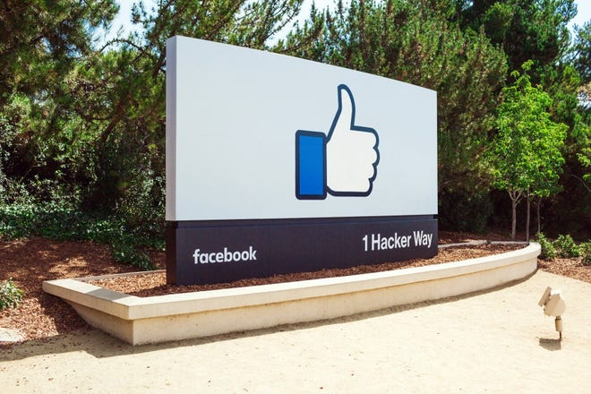 """A file photo of the """"Like"""" sign at Facebook headquarters. Crossroads Church has shared a story of how an Easter video showing the crucifixion of Jesus Christ was flagged for violence and blocked temporarily by Facebook."""