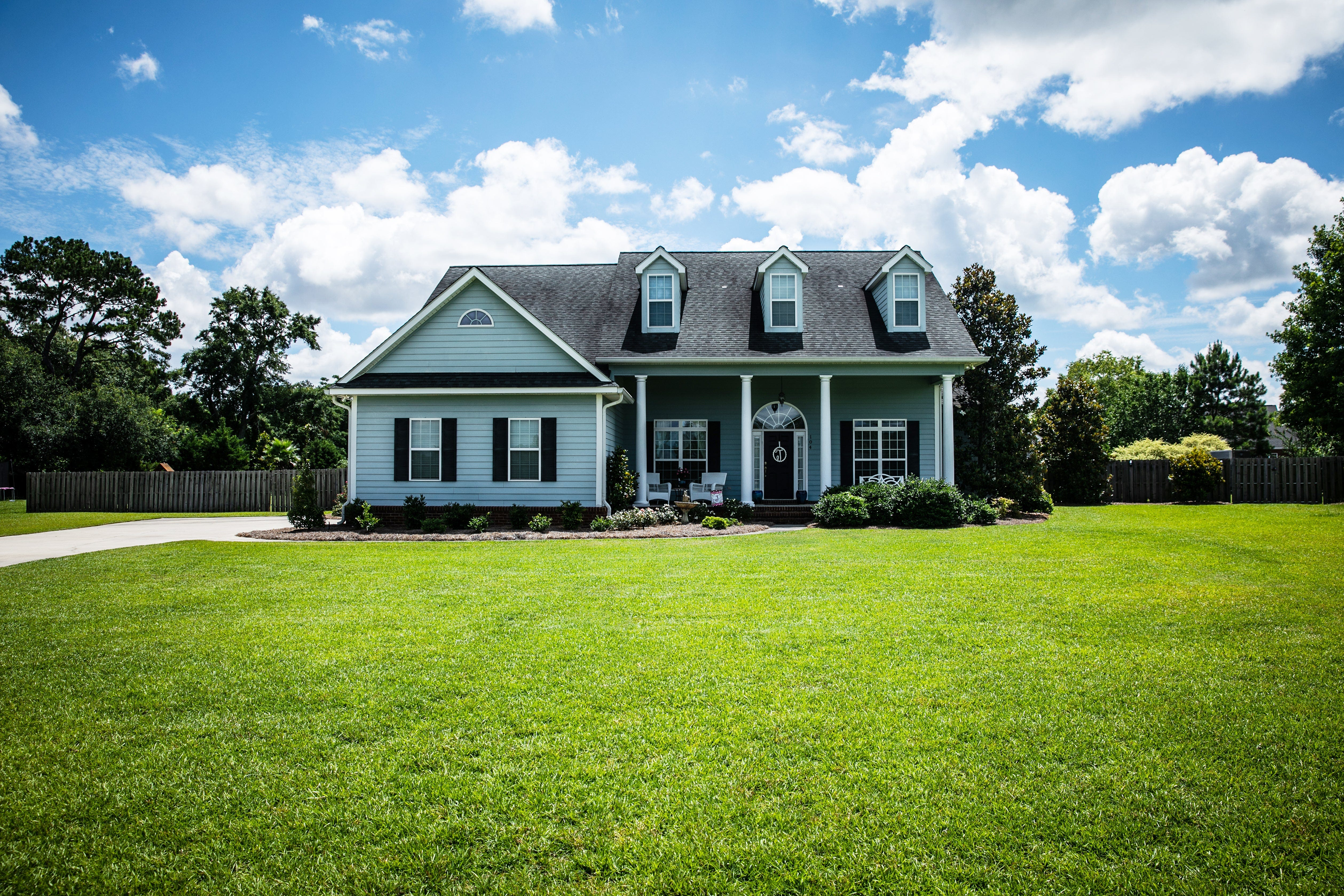 Picture of home on big grassy lawn.