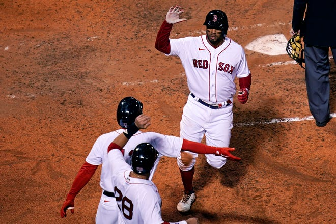 Xander Bogaerts crosses the plate during Monday night's Red Sox spanking of the Rays.