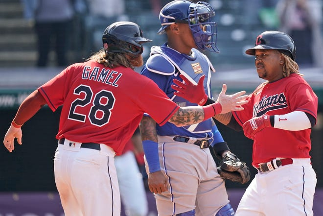 Cleveland's Jose Ramirez, right, is congratulated by Ben Gamel after Ramirez hit a two-run home run in the eighth inning of a baseball game, Wednesday, April 7, 2021, in Cleveland. Cleveland won 4-2. [Tony Dejak/Associated Press]