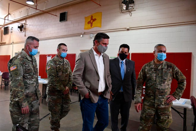 U.S. Sen. Martin Heinrich, D-N.M., visits with members of the New Mexico National Guard during a tour of a vaccination distribution site in Albuquerque on Tuesday.