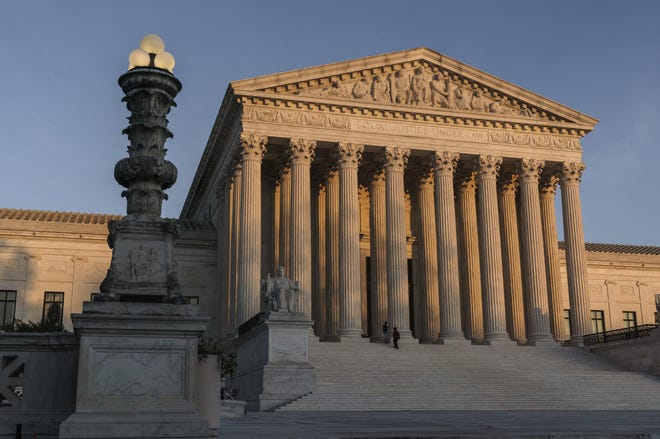 The Supreme Court is seen at sundown in Washington in November 2020. In an order on April 9, 2021, justices told California that it can't enforce coronavirus-related restrictions that have limited home-based religious worship including Bible studies and prayer meetings.