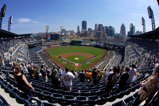 A limited number of baseball fans stand for the National Anthem before an April 8 game between the Pirates and the Chicago Cubs at PNC Park in Pittsburgh. (AP Photo/Gene J. Puskar)