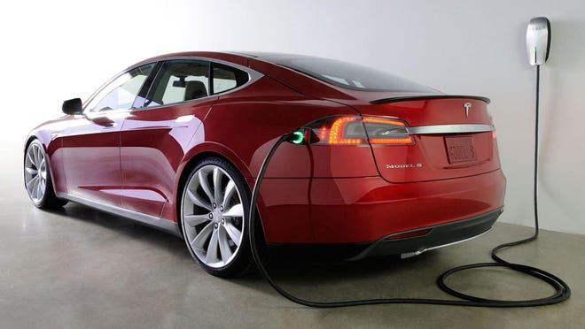 A Tesla Model S connected for charging.