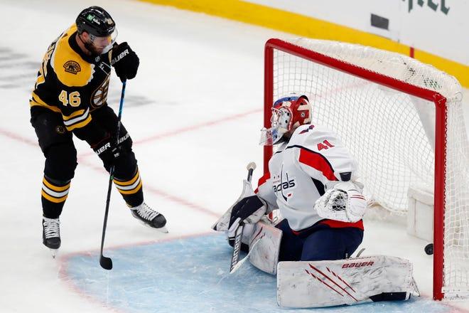 Boston Bruins' David Krejci (46) scores on Washington Capitals' Vitek Vanecek (41) during the first period of an NHL hockey game, Sunday, April 18, 2021, in Boston. (AP Photo/Michael Dwyer)