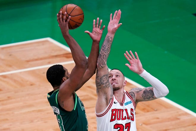 Chicago Bulls center Daniel Theis, right, tries to block Boston Celtics center Tristan Thompson, left, during the first half of a game on Monday, April 19, 2021, in Boston.