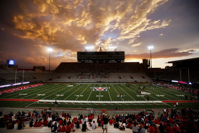 A stunning sunset paints the sky over the Arizona Wildcats football meet the team night on Friday, Aug. 15, 2014, at Arizona Stadium in Tucson, Ariz. Photo by Mike Christy / Arizona Daily Star