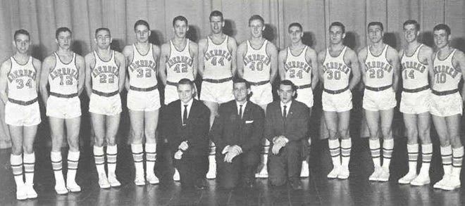 """Central's 1961 State A champion basketball team was, back row, from left, Jerry Larson, Jerry Ryan, Roger Smith, John Mertz, Bob Rylance, Tom Malchow, Knute Lee, Dennis Schumacher, Jerry Hauck, Bob Lehr, Jim Olson and Ron Klingman, front row, Assistant student manager Bill O'Keefe, Coach Lyle """"Bud"""" Belk, Student Manager George Godfrey. Courtesy photo"""
