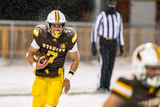 Wyoming's Trey Smith looks for running room during the Cowboys' game against Boise State on Dec. 12, 2020, at War Memorial Stadium in Laramie.