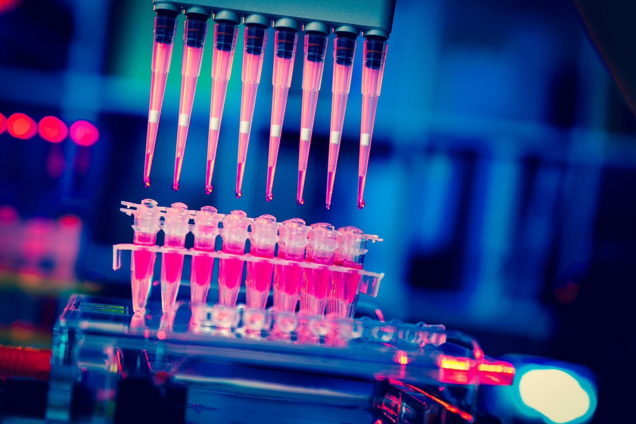 A device places liquid into test tubes under ultraviolet light.