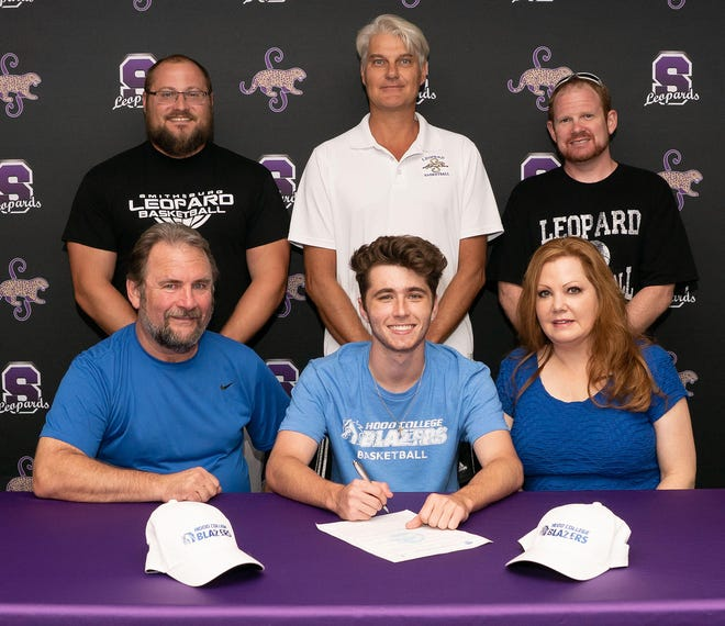 Bryce Keller committed to Hood College on Monday to continue his academic and basketball career. Keller averaged 10 points per game last season. He played only half the season due to injury, yet led the Leopards with 34 made 3-pointers, shooting 38%. He also led the Leopards in free throw percentage (83%). Pictured in the front row from left to right are Kim Keller, Bryce Keller and Rachel Keller. In the back are Smithsburg athletic director Ryan Myers, basketball coach Eric Gerber and coach Tim Miller.
