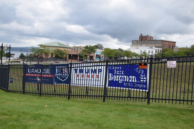 Several political signs are seen on display Sept. 2 at 200 E. Lake St. in downtown Petoskey. Earlier, the signs had been attached to the outside of the property fence.
