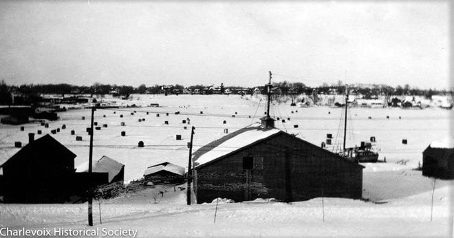 Before the winter warming trend, dozens of ice fishing shanties were constructed each year on Round Lake. This photo is circa 1920.