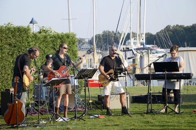 A band plays in Marina Park in Harbor Springs during a 2018 Street Musique event.