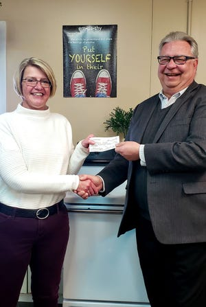 Dave Synder presents a check to Melissa Costello.