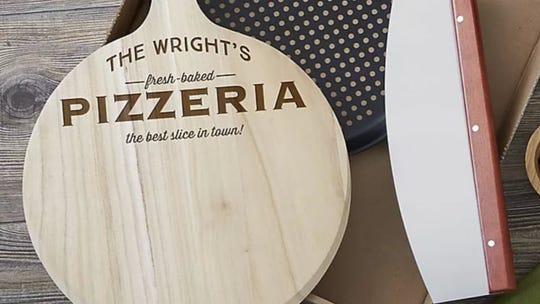 This set includes a pizza board, a non-stick pizza crisper pan, and a pizza rocker.
