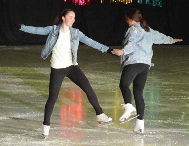 Kelsey Heath (left) and Hallory Kohl momentarily clasp hands as they spin through their routine during Saturday's Summer Vacation Ice Show at the Maas Ice Arena. Three performances of the Watertown Figure Skating Club's annual show were held over the weekend.