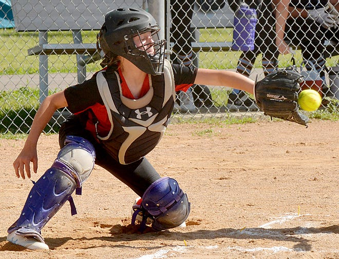 Watertown Abra catcher Cyndi Kudrna reaches to catch a pitch to the plate during a 10-and-under girls division game over the weekend in the Watertown Fastpitch Softball Association's Premier Throwdown tournament at Koch Complex and Foundation Fields.