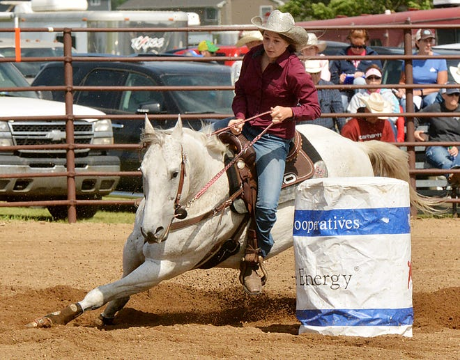 Kailee Berger of Ortley guides her horse around the final barrel during the girls' barrel racing event Sunday in the Watertown Regional High School Rodeo at Derby Downs.