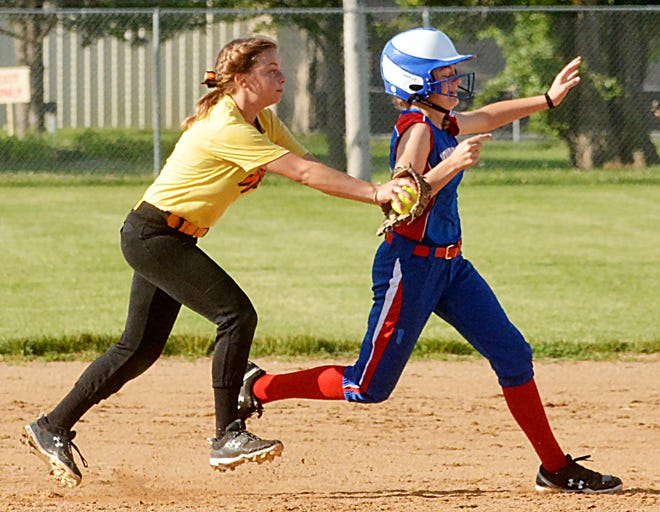 Third baseman Kenley Grewe of the Watertown Wildfire (left) tags out Sioux Falls XPlosion base runner Chloe Johnson during their 12-and-under game over the weekend in the Watertown Fastpitch Softball Association's Premier Throwdown tournament at Koch Complex and Foundation Fields.