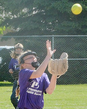 Shortstop Kodi Lund of Watertown Premier attempts to haul in an infield fly during a 12-and-under division game over the weekend in the 45th Joe Young Memorial Girls Fastpitch Softball Tournament at Koch Complex.