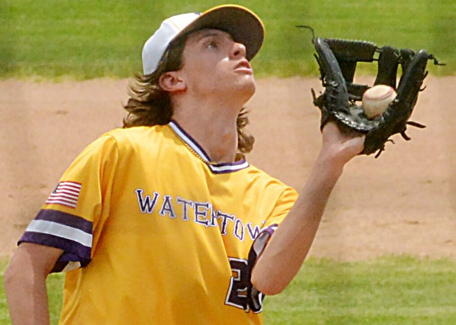 Watertown Post 17 pitcher Cole McElhany catches a pop during the first game of Sunday's season-opening baseball doubleheader at Watertown Stadium. Post 17 beat Aberdeen 13-3 in the first game of the twinbill.