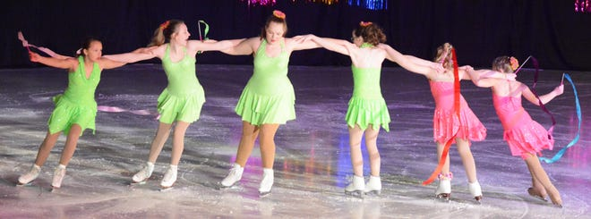 Skaters (from left) Savannah Sovell, Gracie Riter, Katie Leadabrand, Layla Peterson, Courtlyn Paulson and Lennix Adler turn together in a circle while performing their routine during the Watertown Figure Skating Club's ice show Saturday. Twenty-four acts were performed in all three sessions of the show held over the weekend.