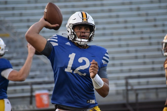 Wyoming quarterback Sean Chambers throws a pass during practice on Oct. 12, 2020, at War Memorial Stadium in Laramie. When healthy, Chambers has been UW's starter since the end of the 2018 season.