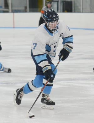Petoskey's Ethan Decker works the puck into TC West's zone during the opening period.