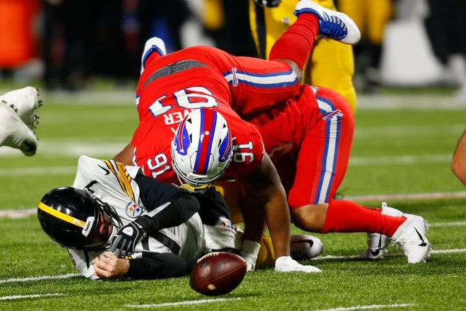 Pittsburgh Steelers quarterback Ben Roethlisberger (7) fumbles the ball as he is sacked by Buffalo Bills defensive tackle Ed Oliver (91) and Vernon Butler (94) during the second half of an NFL football game in Orchard Park, N.Y. last season.