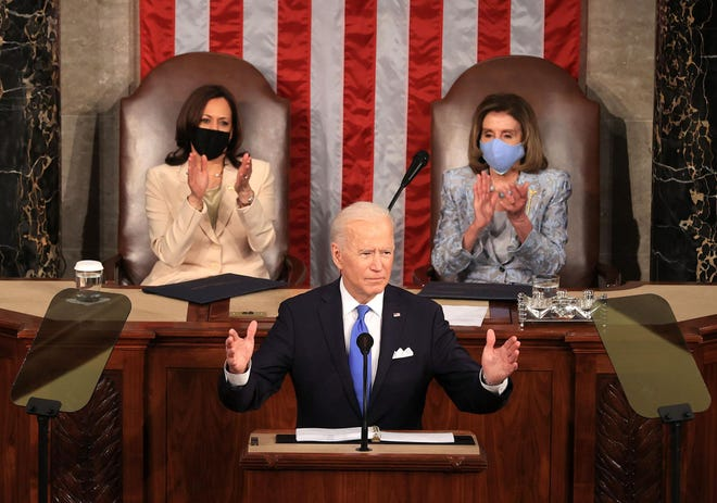 President Joe Biden, flanked by Vice President Kamala Harris, left, and Speaker of the House of Representatives Nancy Pelosi addresses a joint session of Congress at the U.S. Capitol in Washington, D.C., on Wednesday, April 28, 2021. (Chip Somodevilla/Getty Images/TNS)