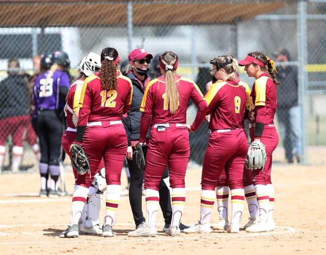 Northern State head coach Jenny Fuller talks with her infield during the third inning in Saturday's doubleheader against the University of Sioux Falls. American News photo by Jenna Ortiz, taken 04/17/2021.