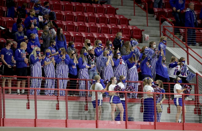 Warner student fans cheer during Thursday night's Class 9A football championship game at the DakotaDome in Vermillion. American News photo by John Davis taken 11/12/2020
