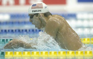YOKOHAMA- AUGUST 25: Michael Phelps from the USA swimming in the 400m individual medley heats during the 2002 Pan Pacific Swimming Championships at Yokohama swimming pool in Yokohama, Japan on August 25, 2002. (Photo by Sean Garnsworthy/Getty Images).