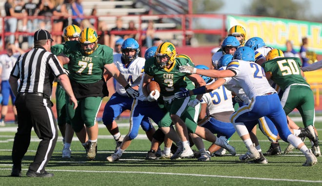 Roncalli's Maddox May, center, breaks through the line as Redfield's Sean Domke, right, closes in on defense during 2020- game at Swisher Field. American News file photo