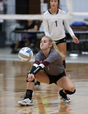Aberdeen Christian's Mary Fites reaches to dig out a serve as teammate Joy Rohrbach looks on during Friday night's match against James Valley Christian at the Aberdeen Christian School gym. American News photo by John Davis taken 10/9/2020