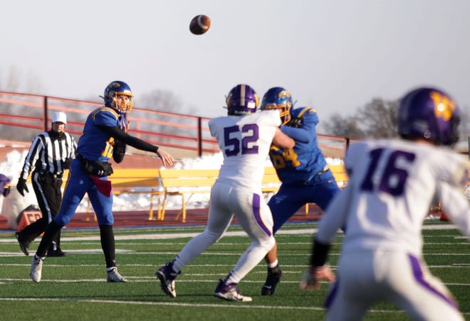 Aberdeen Central quarterback Sam Rohlfs throws the ball while Brady Rohrbach (64) blocks Watertown's Tyler Dean during Friday's game at Swisher Field. American News photo by Jenna Ortiz taken 10/23/2020.