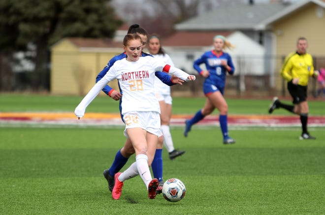 Northern State midfielder Lilja Davidsdottir obtains possession of the ball against UMary defender Elizabeth Gilbertson for the ball during Saturday's scrimmage at the NSU Soccer Pavilion. American News photo by Jenna Ortiz, taken 03/27/2021.