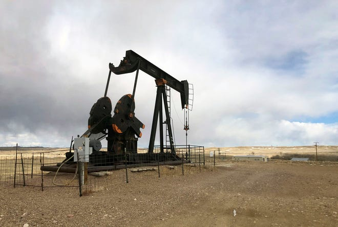 An oil well is seen east of Casper, Wyo., on Feb. 26, 2021. President Joe Biden's administration is at odds with the petroleum industry in the Rocky Mountain region and beyond for imposing a moratorium on leasing federal lands for oil and gas production.