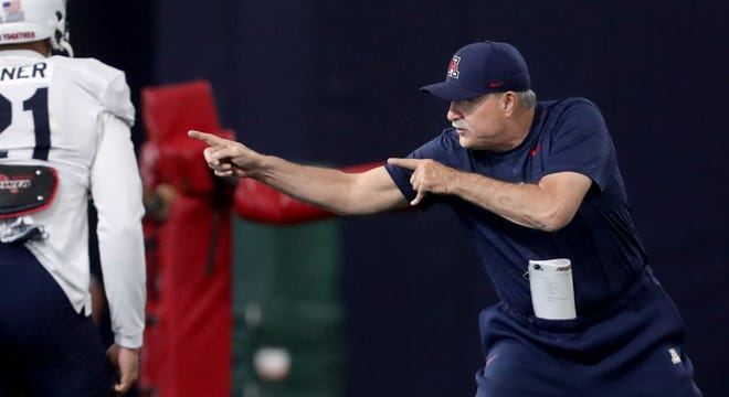 University of Arizona defensive coordinator Don Brown tells his unit just how he wants the drill to run during a spring practice at Dick Tomey fields, Tucson, Ariz., April 13, 2021.