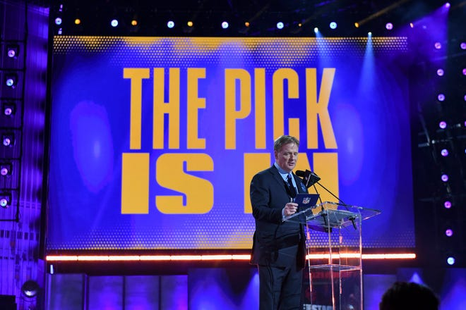 NFL Commissioner Roger Goodell addresses the crowd as the first round of the NFL football draft finishes early Friday, April 30, 2021, in Cleveland. (AP Photo/David Dermer)