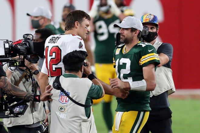 Tampa Bay Buccaneers quarterback Tom Brady, left, shakes hands with Green Bay Packers quarterback Aaron Rodgers after the Bucs defeated the Packers Sunday, Oct. 18, 2020, in Tampa, Fla.