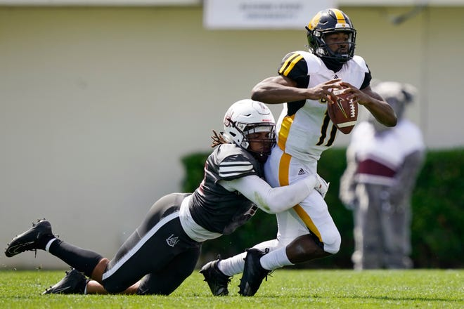 Arkansas-Pine Bluff quarterback Skyler Perry (11) is sacked by Alabama A&M defensive end Marcus Cushnie during the first half of the Southwestern Athletic Conference championship NCAA college football game Saturday, May 1, 2021, in Jackson, Miss. (AP Photo/Rogelio V. Solis)