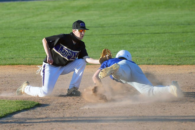 Williamsport's Brady Neff is out trying to steal second base as Smithsburg shortstop Dylan Moser applies the tag during the fourth inning Monday at Municipal Stadium.