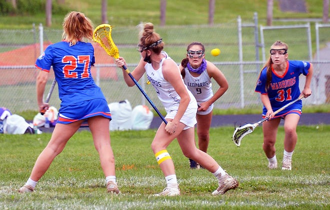 Smithsburg's Maddie Kesselring (9) and Boonsboro's Ava Selby (31) charge for the ball after the Warriors' Kayla Martin (27) and the Leopards' Brianna Ellis (3) battled for a draw on Thursday during first half of Boonsboro's 14-13 victory.