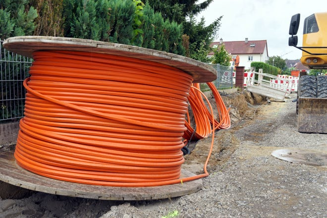 Broadband cable is seen at a construction site.