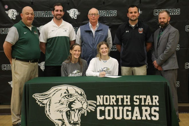North Star senior Steph Emert, center, poses for a photo after signing her National Letter of Intent to play basketball at Juniata College, Thursday, in Boswell. She is pictured with, front, mother Jadie Leazier, back, North Star principal Thad Kiesnowski, Cougars assistant basketball coach Bryan Ridilla, athletic director Stacy Schmitt, head coach Joe Zimmerman and superintendent Louis Lepley.