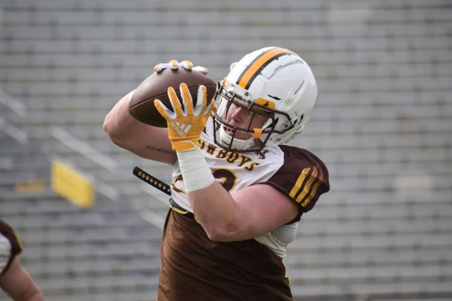 Wyoming linebacker Easton Gibbs runs through a drill during spring practice April 13 at War Memorial Stadium in Laramie. Gibbs is pushing incumbent Chuck Hicks for the starting job at outside linebacker.
