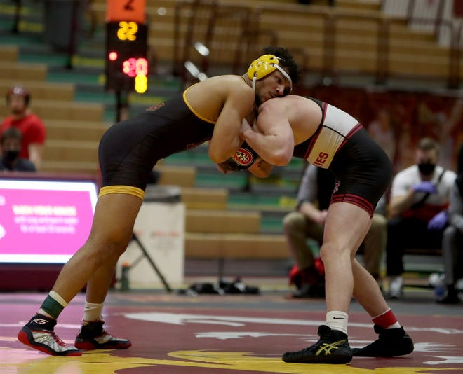 Northern State's James Burks holds St. Cloud State's Devin Fitzpatrick during the semifinal round of the 165 match at the NCAA Super Regional V on Saturday in Wachs Arena. American News photo by Jenna Ortiz
