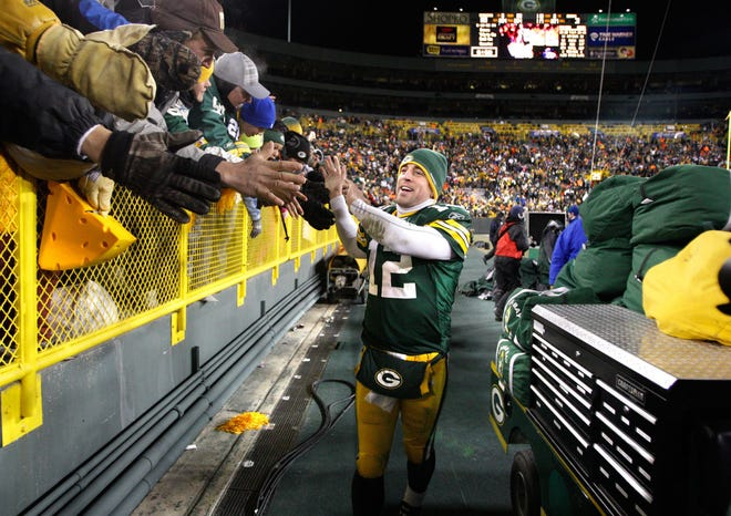 Aaron Rodgers took a lap around the stadium to greet fans after the Packers beat the Chicago Bears 10-3 on January 2, 2011.